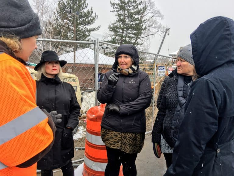 Marci Pattillo asks Kathleen Wanatowicz about the new traffic pattern after the completion of the new Grand Avenue traffic bridge. | The Property Shop, Inc.