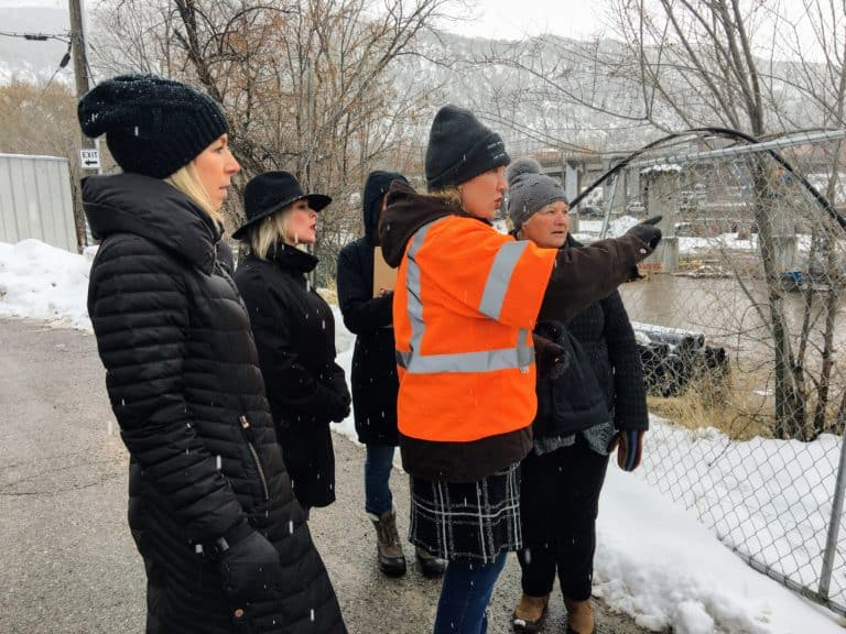 The Property Shop Brokers look at the progress on the Grand Avenue Bridge project from the north side of the job site | The Property Shop, Inc.